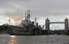 A British battleship that survived World War Two, the HMS Belfast, recreates the moment the first guns were fired in Normandy on June 6, 1944. — Reuters