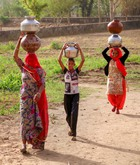 Villagers carry vessels after collecting water during a hot summer day in Ajmer, Rajasthan, on June 7, 2019. PTI photo