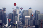 Hot air balloons fly over Canary Wharf during the Lord Mayors Hot Air Balloon Regatta in London, Britain June 9, 2019. — Reuters