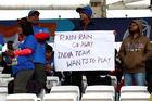 Fans wait as rain delays a match between India and New Zealand during the ICC Cricket World Cup at the Trent Bridge, Nottingham, Britain, on June 13, 2019. — Reuters
