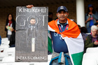 Fans with a banner wait as rain delays a match between India and New Zealand during the ICC Cricket World Cup at the Trent Bridge, Nottingham, Britain, on June 13, 2019. — Reuters