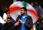 Indian fans wait as rain delays a match between India and New Zealand during the ICC Cricket World Cup at the Trent Bridge, Nottingham, Britain, on June 13, 2019. — Reuters