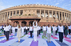 Lok Sabha Speaker Om Birla, Parliamentary Affairs Minister Prahlad Joshi, BJP General Secretary Bhupender Yadav along with other MPs and officials perform Yoga during the 5th International Day of Yoga at Parliament, in New Delhi, Friday, June 21, 2019. Tribune Photo: Mukesh Aggarwal