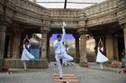 Indian yoga practitioners take part in a yoga session on International Yoga Day at the 15th century Adalaj Stepwell in Adalaj, some 40km from Ahmedabad in western Gujarat state, on June 21, 2019. — AFP