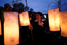 Festival goers stand with lanterns at the stone circle during Glastonbury Festival at Worthy farm in Somerset, Britain, on June 26, 2019. — Reuters