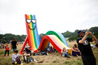 Revellers relax in the sun at the Park area of Glastonbury Festival at Worthy farm in Somerset, Britain, on June 26, 2019. — Reuters