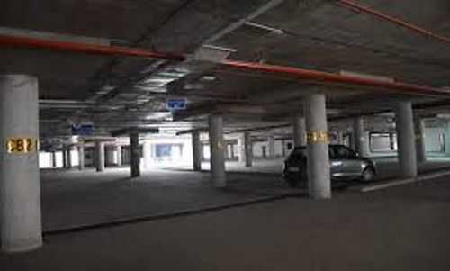 Multi-level lot leaks, adds to parking woes
