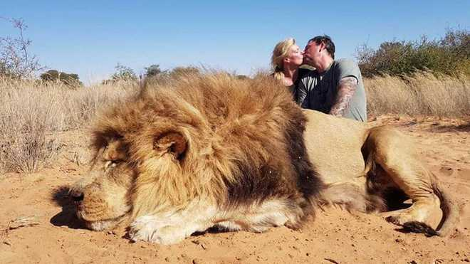 Internet sees red over this Canadian couple's photo after hunting lion