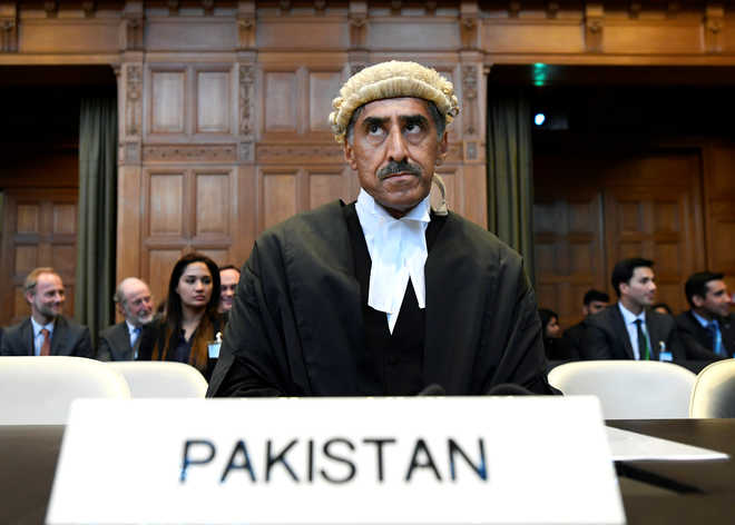 Will proceed 'as per law' in Jadhav case, says Pak after ICJ verdict