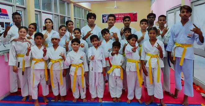 Yellow belt for 13 karatekas