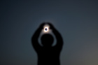 A person gestures while observing a solar eclipse at Incahuasi, Chile, July 2, 2019. — Reuters