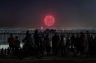 People gather on the Mexican side of the US-Mexico border fence to watch the Fourth of July fireworks being shot on the other side on the San Diego Bay, in Playas de Tijuana, Baja California State, July 4, 2019. — AFP