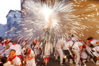 Revellers run next to the Fire Bull, a man carrying a bull figure packed with fireworks, during the San Fermin festival in Pamplona, Spain, July 7, 2019. — Reuters