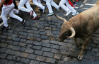 Revellers run near bulls and steers during the running of the bulls at the San Fermin festival in Pamplona, Spain, July 12, 2019. — Reuters