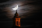 The basilica church tower is seen in front of the moon during a partial lunar eclipse in Weingarten, Germany, on July 16, 2019. — AFP
