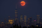 The full moon rises above the New York City skyline on the 50th anniversary of the Apollo 11 moon launch, on July 16, 2019. — AP/PTI