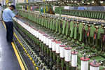 Textile spinning mills mull cutting on production