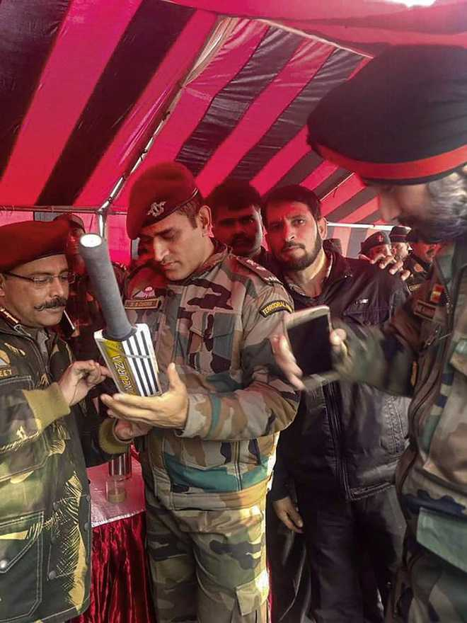 Image result for ms dhoni in military dress with ak 47