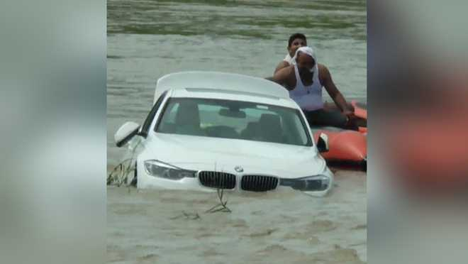 Denied Jaguar, angry Haryana youth pushes new BMW into river