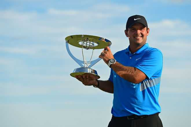 Reed tames Ancer, wins Northern Trust