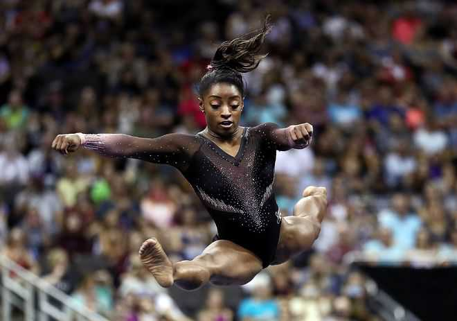 Biles soars to sixth title