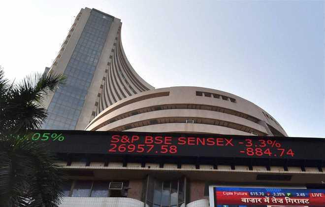 Sensex drops over 200 points; RIL soars 8 per cent