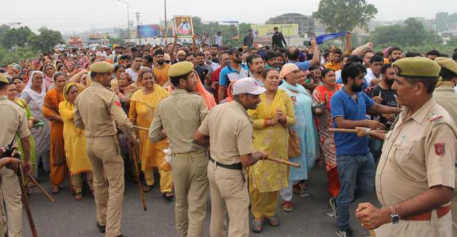 Protest over temple demolition stalls traffic