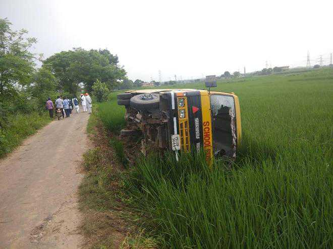 School bus overturns, none hurt