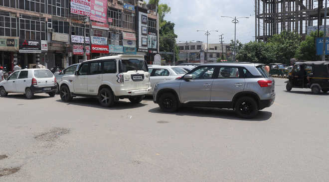 Haphazard parking along roads leads to traffic snarls