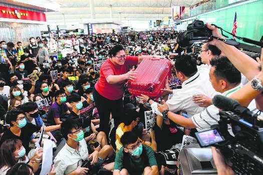 Hong Kong airport halts check-ins