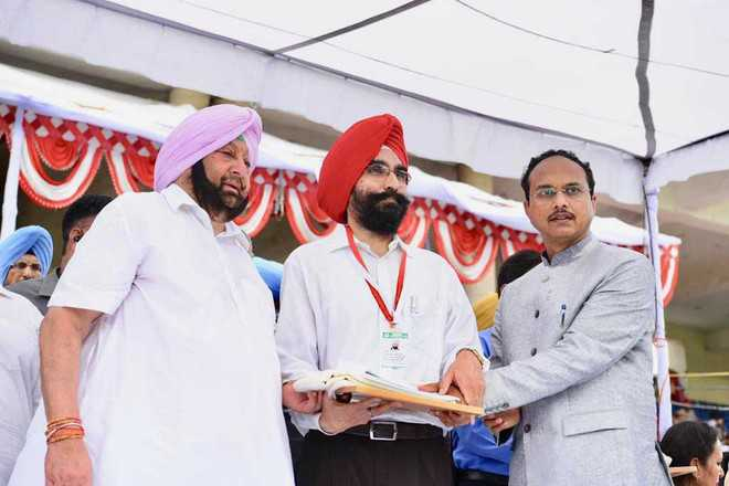 Chief Minister confers award on Dr Sandhu