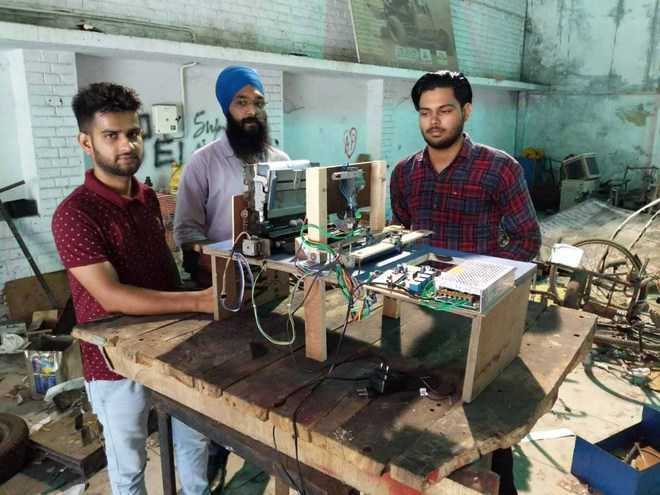 GNDEC students develop automatic stamping machine