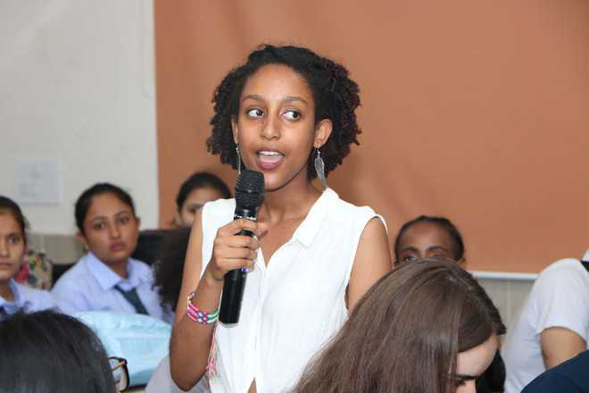AIESEC members interact with CT University students