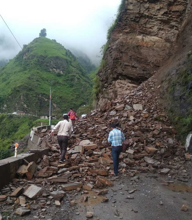 Dharamsala road buried under debris