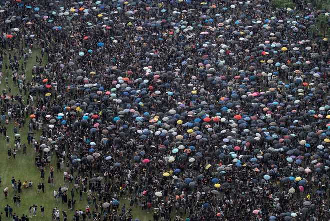 Thousands of Hong Kongers brave rain to join anti-govt rally