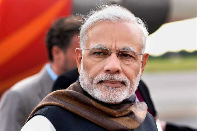 In telephone talks with UK PM, Modi raises violence against Indian diaspora on I-Day in London