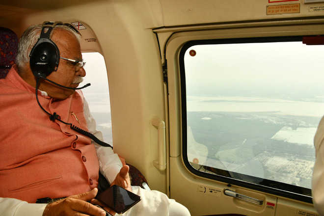 Khattar conducts aerial survey of flood-hit areas