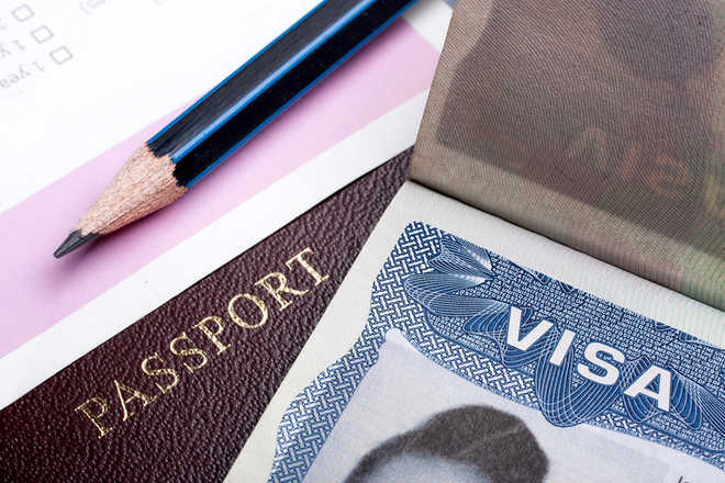 Woman agent held for immigration frauds