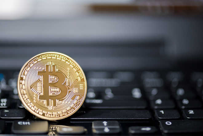 Indian-origin Canadians charged in US with bitcoin fraud