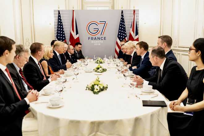 Trump backs 'right man' Johnson at fractious G7 summit