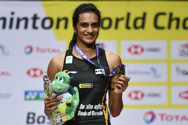 PV Sindhu first Indian shuttler to win World Championships gold