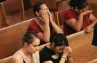 Women react at the conclusion of a vigil at St Pius X Church, held for victims after a mass shooting which left at least 20 people dead, on August 3, 2019 in El Paso, Texas. — AFP