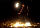 An Egyptian performer plays with fire during a show on the beach as an entertainment for tourists and Egyptians at the Red Sea resort of Hurghada, Egypt on July 28, 2019. — Reuters