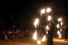 Egyptians perform during fire show on the beach as an entertainment for tourists and Egyptians at the Red Sea resort of Hurghada, Egypt on July 28, 2019. — Reuters