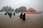 Members of a rescue team wade through a water-logged area past a submerged temple during heavy rains on the outskirts of Kochi in Kerala on August 8, 2019.Reuters
