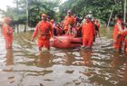 In this handout photograph taken and released by the National Disaster Response Force (NDRF) on August 9, 2019, NDRF personnel rescue people stranded in flood waters on inflatable boats after heavy rains on the outskirts of Sangli in Maharashtra. AFP photo