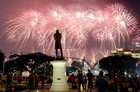 A statue of Sir Stamford Raffles is seen as spectators watch fireworks explode during Singapore's 54th National Day Parade in Singapore August 9, 2019. — Reuters