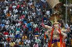 Motorists follow as devotees take an idol of the elephant-headed Hindu deity Lord Ganesha to a temporary makeshift temple from a workshop ahead of the Ganesh Chaturthi festival in Mumbai on August 15, 2019. — AFP