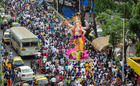 Devotees carry Ganesh idols to the 'pandals' ahead of the upcoming Ganesh festival in Mumbai on August 15, 2019. — PTI.