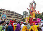 Devotees carry Ganesh idols to the 'pandals' ahead of the upcoming Ganesh festival in Mumbai on August 15, 2019. — PTI